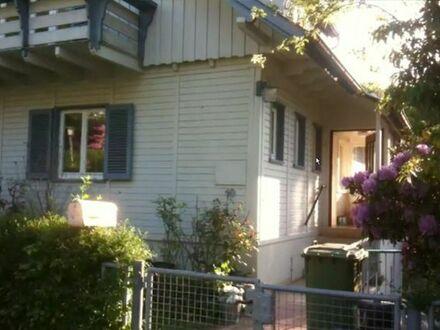 Einfamilienhaus im Chalet Stil mit kleiner Einliegerwohnung im EG