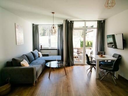 Oberstdorf - Stilvolle, neuwertige 1-Zimmer-EG-Wohnung mit Balkon, Schwimmbad, Sauna, Tennisplatz in Oberstdorf