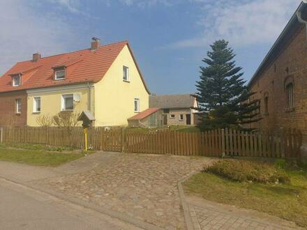 Milow - Doppelhaushälfte in 17337 Milow - mit großem Grundstück