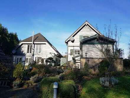 Einmalig: 2 freistehende Einfamilienhäuser in bestem Zustand auf herrlichem Grundstück