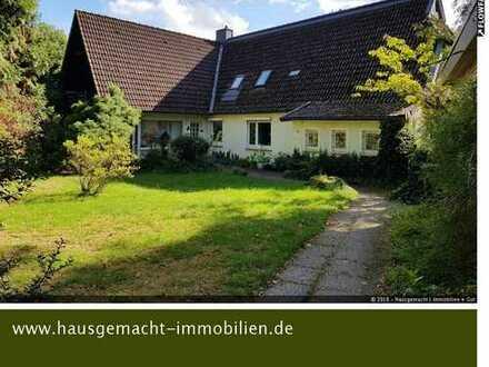 Liebhaberobjekt! Ansprechendes Doppelhaus mit großem Grundstück zu verkaufen