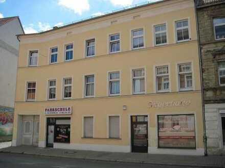 Neuendorfer Straße 82 - Wohn- und Geschäftsgebäude