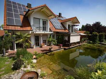 Schönes Haus mit Schwimmteich und traumhaftem Garten - eine Wohlfühloase