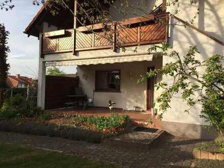 EG Wohnung mit zusätzlichem Kellerapartment, Sauna und Gartenanteil