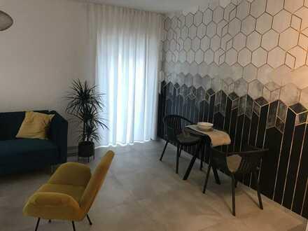 Erstbezug: stilvolle 2-Zimmer-Erdgeschosswohnung mit Terrasse