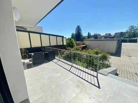 Moderne, lichtdurchflutete Erdgeschosswohnung mit großzügiger Terrasse