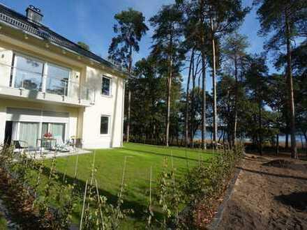 Wohnen mit besten Standard, traumhaften Seeblick und eigenem Garten