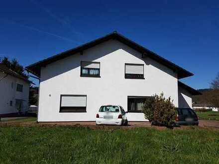 ***Kapitalanlage***- Rendite Zweifamilienhaus mit Werkshalle und ca. 2797 m² großem Grundstück