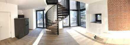 Exklusives Wohnen im historischen ERBA-Turm - Galeriewohnung im EG mit Terrasse und Garten