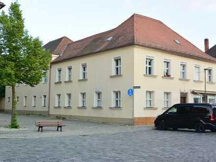 **Denkmalgeschütztes Mehrfamilienhaus mit Anbau**