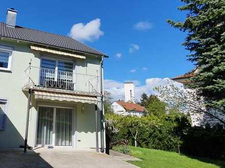 3-4 ZKB Wohnung in einem Zweifamilienhaus mit Südbalkon und Garten