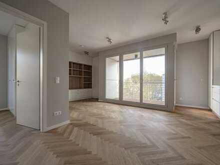 Edle 2 Zimmer-Wohnung mit Fischgrät-Parkett, bulthaup Küche und Loggia - Bezugsfertig!
