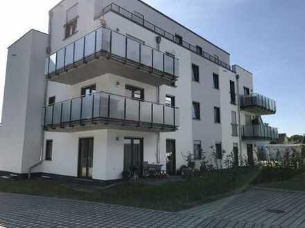 neuwertige Erdgeschosswohnung mit Terrasse + Garage