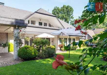 Exklusive Villa mit Einliegerwohnung und Nebengebäude: ruhig gelegen im Herzen von Harsewinkel!