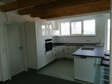 DG-Wohnung mit Einbauküche als Neubau innenstadtnah