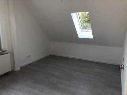 2-Zimmer-Wohnung mit Tiefgarage, Erstbezug nach Kernsanierung mit Einbauküche