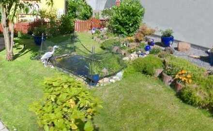 HAUS IM HAUS - Schicke Eigentumswohnung mit eigenem Garten und Garage