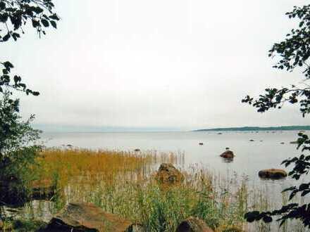 Voigt Immobilien: Traumhaftes Ferien-Grundstück am Meer mit Sauna/- und Bootshaus in Finnland