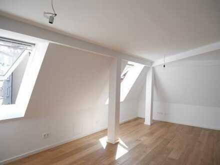 Erstbezug nach Dachgeschossausbau - Helle 2 Zimmerwohnung mit hochwertiger EBK