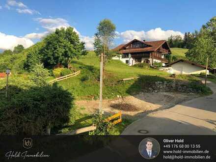 Eine seltene Gelegenheit: Grundstück mit Genehmigung für Einfamilienhaus - Bergblick inklusive
