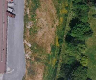 Tairnbach: Sonniges, teilweise erschlossenes Gewerbegrundstück mit Wohnhausbebauung