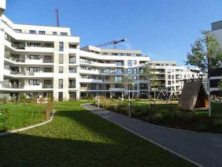 Neubau; exclusive Dreizimmerwohnung mit Wintergartenbalkon, Gäste WC, TG, Parkett, Fußbodenheizung