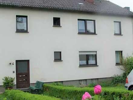 Schöne 3-Zimmer Wohnung im 1. Obergeschoss mit Garten und zwei Stellplätzen