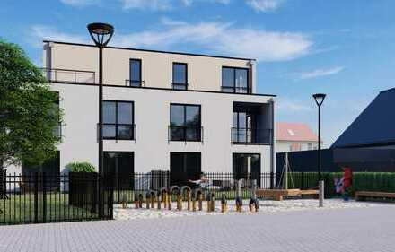 Eine Neubauwohnung die sich sehen lassen kann mit eigenem Gartenanteil.