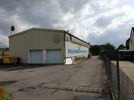 Gewerbehalle mit 6 Garagen mit Ausbaukapazität zu 2 Wohnungen