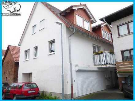 Niedermittlau: Mehrfamilienhaus mit 3 Wohnungen und 3 Garagen, aufgeteilt nach WEG