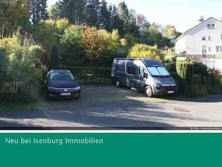Wohnen am Bach: Baugrundstück + 4 Garagen inklusive