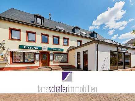 Appartementhaus mit Restaurant und großer Wohnung