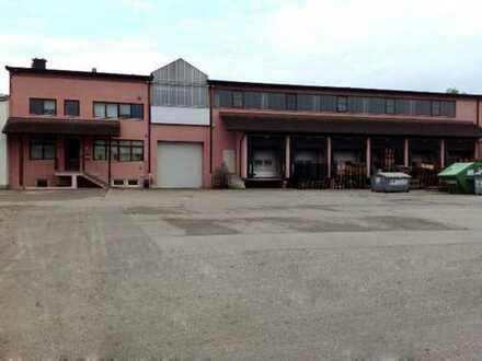 Lagerhalle mit Büroräumen und 6 Verladetoren für LKW-Lieferungen