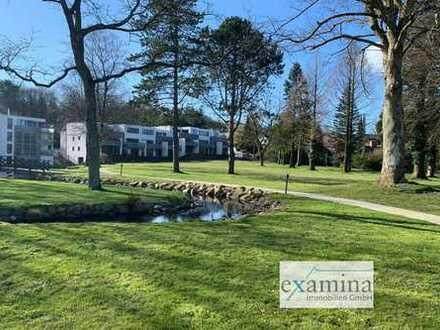 Schöne Eigentumswohnung mit traumhaftem Ausblick, Zugang zur Förde und wunderschöner Parkanlage.