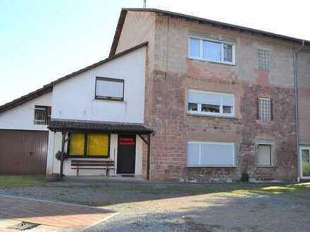 Freistehendes Einfamilienhaus mit Friseurgeschäft/Ladengeschäft sowie Einliegerwohnung