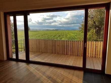 Energieplushaus mit Balkon: freundliche helle 4-Zimmer-Wohnung auf dem Energiehof Liebon
