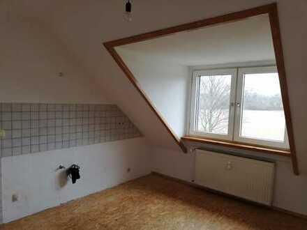 ***Gemütliche 3 Zi. Dachgeschosswohnung in zentraler Lage***.