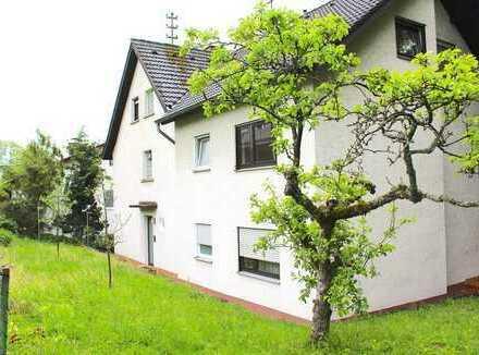 Großzügige Erdgeschosswohnung mit Garten, eigener Garage und Stellplatz