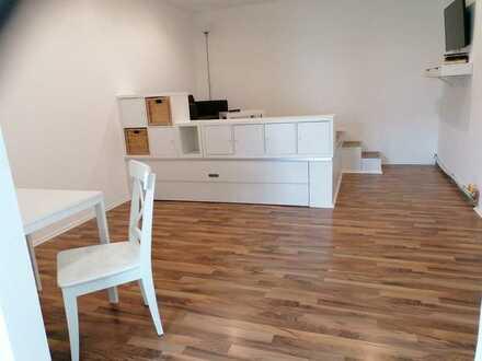 Erstbezug nach Sanierung: Vollmöblierte exklusive 1-Zimmer-Wohnung mit Einbauküche und Terrasse .