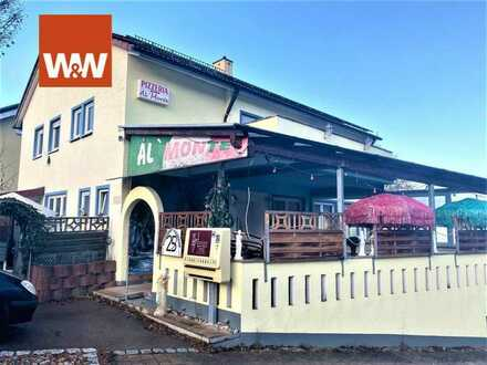 Wohn- und Geschäftshaus (Pizzeria) mit  3 Wohnungen, 2 Photovoltaikanlagen  und 2 Garagen