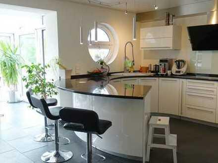 Exclusive Penthouse Wohnung mit großer Sonnenterrasse und Garten