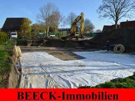 # Friedrichskoog: Sonnige Neubau-Terrassenwohnung mit Kamin und großem Garten!