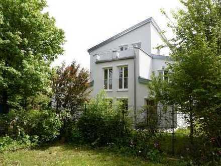 CASACONCEPT Modernes großzügiges Eckhaus mit großem Garten