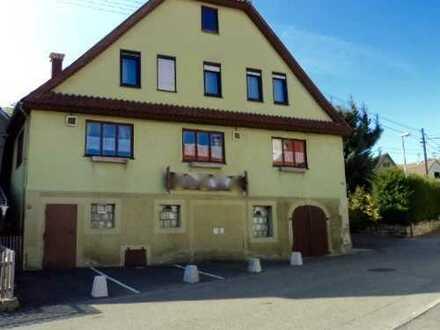 Gaststätte mit Wohnung, Scheunengebäude und Garage