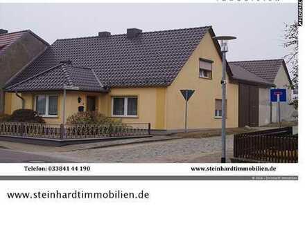Ländlich gelegenes Einfamilienhaus mit Nebengebäuden, Werkstatt, Garagen und Garten