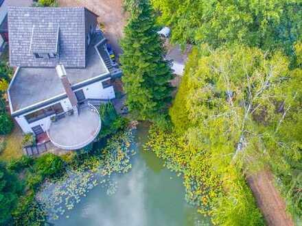 Haus am See! Ein-/Zweifamilienhaus auf Traumgrundstück mit eigenem See-Anteil in 53229 Bonn!