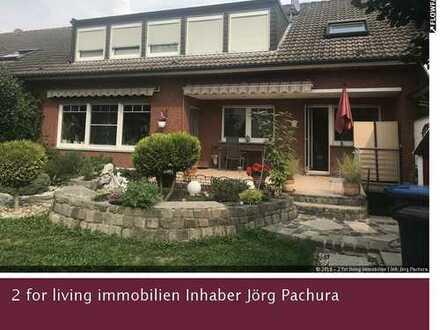 RESERVIERT! Attraktives Zweifamilienhaus mit hochwertiger Ausstattung und schönem Garten!
