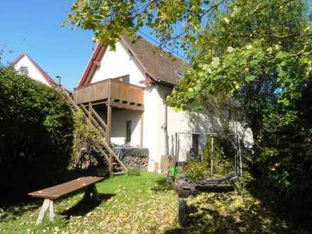 Solides Eigenheim mit Kfz.-Werkstatt und idyllischem Garten!