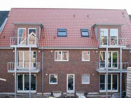 Neubau EG-Wohnung mit innenliegender Garage in der Innenstadt