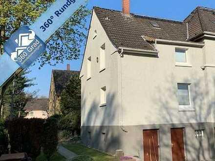 Gartenglück in der Eisenbahnersiedlung: Reihenendhaus in Duisburg-Wedau